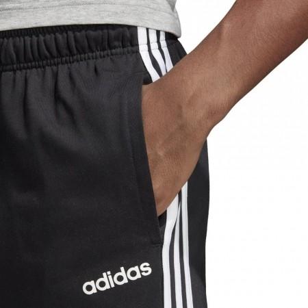 Spodnie adidas Essentials 3 Stripes Tapered Pant SJ OH DU0456
